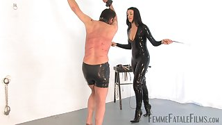 Latex slut The Hunteress tortures her male slave with brutal spanking
