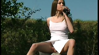 Horn-mad village young chick exposes her sexy thighs to the fullest extent a finally peeing outdoors