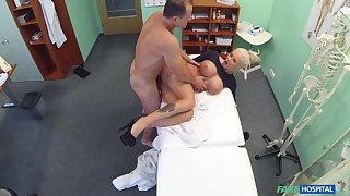 Chesty blonde whore gets some action in the doc's office