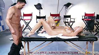 Wild pussy plus tits shacking up on the massage table with Abbey Brooks