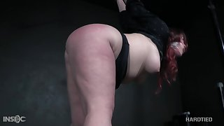 Voluptuous redheaded bitch with a chunky ass gets punished by her bondage master