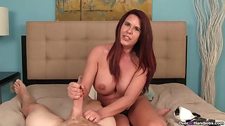 Busty redhead uses her ability to suit slay rub elbows with stepson with a good handjob
