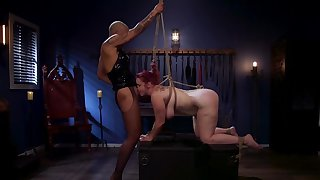 Ebony domme in leather peak turns the redhead into will not hear of slave